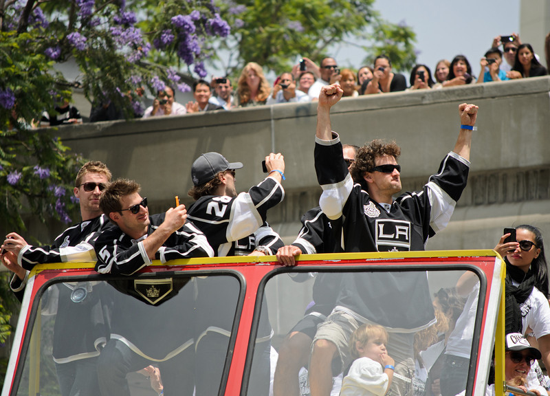 The Los Angeles Kings victory parade in downtown L.A. three days after winning the Stanley Cup by defeating the New Jersey Devils in six games. From left: L.A. Kings players Trevor Lewis, Brad Richardson, Jarrett Stoll and Justin Williams. Dwight King is behind Williams.